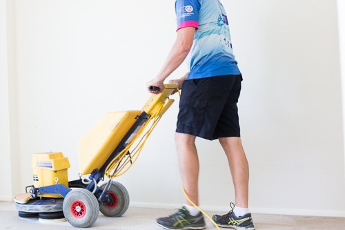 man carpet cleaning cairns with machine in unit block
